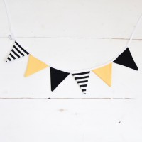White, black and yellow garland of pennants